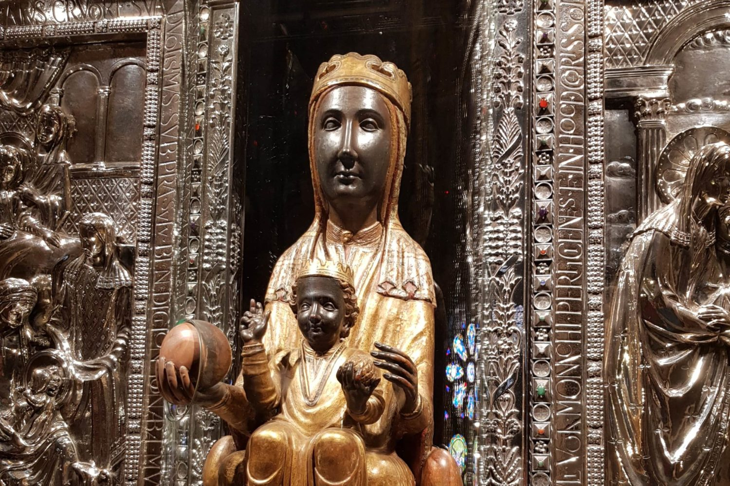 The poly-chrome carving of Saint Mary of Montserrat.
